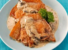 Dress up your plain old fried pork chops with a mushroom cream sauce for added flavor.