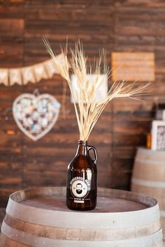 #rustic #wedding #holland #ranch #barn #growler #vase #wheat #dangerous #man #beer #cocktail #hour #wine #barrel #centerpiece
