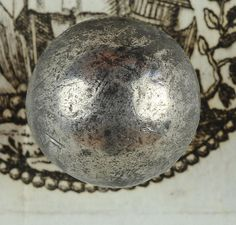 Pewter 1,8 cm Button, mounted on wood