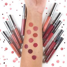 Ok. So funny story. I tried to make some decent looking swatches. Maybe circles because it goes with my confetti background. What does Selina do when she doesn't have any stencils and a very unsteady hand? She takes one of her Christmas cookie shapes. Now it's pretty hard to hold down the shape on your arm and paint liquid lipstick on at the same time with just one hand so she enlisted her boyfriend to hold the cookie shape while talking about herself in the third person. Yeah not only…
