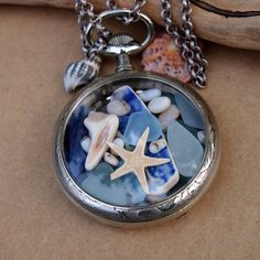 Sea Glass Pocket Watch Pendant Antique French Silver 1890s Lost Treasure. $150.00, via Etsy.