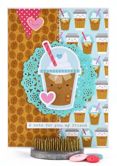 Mmmm...now here's a cute frappucino card that's calorie free and oh-so-adorable. It's paired with a trio of hearts — one atop the dollop of whipped cream, one sitting on the side of the cup and one is a shiny and sweet heart-shaped sugar cookie. #thecardkiosk
