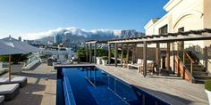 """Cape Town's most impressive piece of real estate, """"The One Above"""" penthouse is The Royal Portfolio's first Private Residence, establishing a graceful footprint in the Mother City. This luxury Cape Town villa boasts Accomodation In Cape Town, Cape Town South Africa, Table Mountain, Most Beautiful Cities, Cool Pools, Luxury Villa, Luxury Travel, City, Places"""