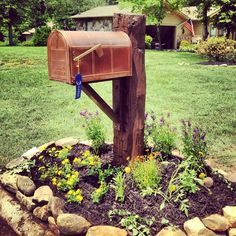 Finally redid mailbox! Old barn beam stained with new copper ... #MailboxLandscape