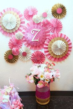 Paper Rosette and Pinwheel backdrop pink and gold with custom initial, perfect for weddings, baby showers, birthdays. Pink and gold rosettes