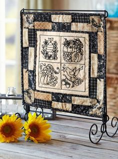 A small quilt stand is perfect for tabletop decor. Use it to display mini quilts, single quilt blocks, or even beautiful embroidery projects. Its compact size fits easily on a table like a picture frame would.