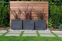 Vertical wood boards to cover up chain link fence with modern concrete planter details