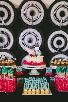 Attention, crafty party planners: you can create a fabulously graphic celebration backdrop with a bunch of black and white honeycomb fans, arranged in a grid.