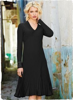 Masterfully engineered in architectural ribs of Salsa-hued pima, this dress is universally flattering in a fit-and-flare shape.