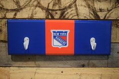 A personal favorite from my Etsy shop https://www.etsy.com/listing/469966733/new-york-rangers-2-hook-hat-coat-rack