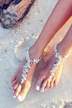 9 Simple Ways to Pull Off a Cool Beach Wedding--wedding shoes for barefoot wedding ceremony, Barefoot Wedding, Beach Wedding Shoes, Beach Wedding Reception, Beach Wedding Decorations, Beach Wedding Favors, Bridal Shoes, Beach Theme Wedding Dresses, Beach Ceremony, Wedding Ceremony