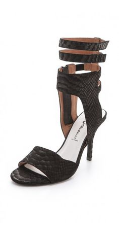 SKYBOX HIGH HEEL SANDALS $198.82 SPECIAL $64.75 YOU SAVE: 67% Python-embossed suede sandals draw dark elegance from their sexy silhouette. A side zip is tucked below the tall stack of ankle straps for easy wear. Covered heel and rubber sole.