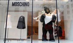 Giant size props at Moschino  - love the interaction with the ape and the bride, another humorous window from this brand.