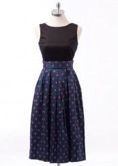 """Closet contrast polka dress featuring a chic tea length skirt that falls below the knee. Has a waist band that ties at the back and a 3/4 length zip on the back. Seen here on a size 8 mannequin with measurements: chest 16"""", waist 14"""", length 44""""."""