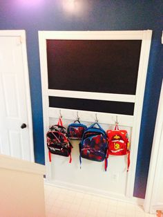 Home organization and decor: DIY kids' backpack wall with chalkboard. Click on link for materials.