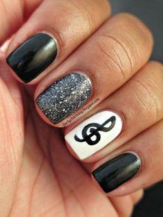 Black/Glitter Gray/White nails w/ a black music note.