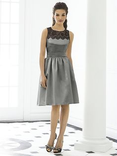 Sleeveless cocktail length matte satin dress w/ black lace yoke and delicately shirred skirt. Belt always matches dress color. Pockets at side seams of skirt.