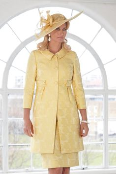 11315 (Condici) Cloque dress with box pleat full skirt and matching jacket in Citrine. The dress is sleeveless with a banded waist. The skirt is full and the length will sit below the knee. The cropped jacket has a rounded neckline, 3/4 length sleeves and satin piping detail.