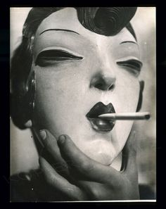 Mask ... Cigarette ... photographer unknown