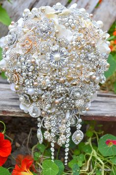 Champagne pearl and gold cascading brooch bouquet by Noaki