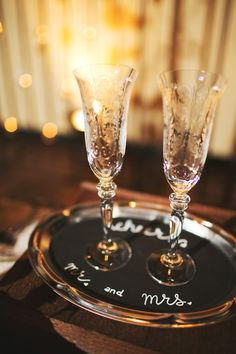 """wedding champagne toasting glasses via anthropologie. mr. and mrs. chalk board tray """"cheers"""""""