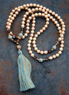 Mala made of 108, 8 mm - 0.315 inch, very special Shell Pearls and decorated with Jasper and faceted Cherry Quartz - Made by look4treasures