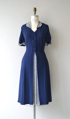 Vintage late 1940s, early 1950s deep atlantic blue rayon dress with white geometric leaf printed round collar, sleeve cuffs and peek-a-boo skirt panel. Fabric button front, side metal zipper, fitted waist and semi-full skirt. --- M E A S U R E M E N T S --- fits like: large bust: 42 waist: 32 hip: 40 length: 46 brand/maker: n/a condition: excellent to ensure a good fit, please read the sizing guide: http://www.etsy.com/shop/DearGolden/policy ✩ layaway is...