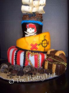 topsy turvy pirate cake with handmade pirate ship www.facebook.com/thepastryhut