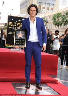 Orlando Bloom received a star on the Hollywood Walk of Fame 2 April 2014  'For a kid in London, Hollywood seems like such a mythical place': Aside from his unkempt hair, Orlando looked dapper posing with the 2,521s...