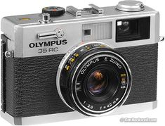 Olympus 35 RC  (another one of my dad's cameras. sticky AE, but still usable)  http://www.kenrockwell.com/olympus/35rc.htm