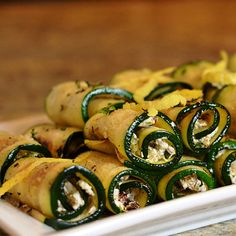 These zucchini rollatini make a fabulous holiday appetizer (to soak up some of that punch...) Clean Eating http://cleaneatingmag.com/Recipes/Recipe/Grilled-Zucchini-Goat-Cheese-Rollatini-with-Raisins-Pistachios.aspx