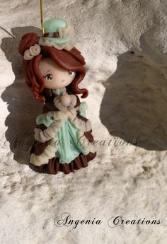 Polymer clay girl in brown dress by Angenia Creations.