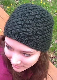 Free Knitting Pattern for Godric's Hollow Hat - Star stitch (or daisy stitch) forms a swirling design inspired by the hat Hermione Granger wears in Harry Potter and the Deathly Hallows Part 1 during the Godric's Hollow scene. Designed by Rebecca Beam. Pictured project by JustineLark