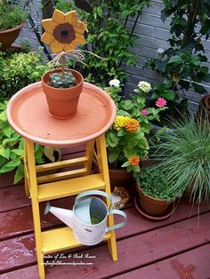 Repurposed step ladder = little side table or birdbath