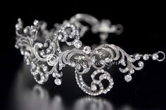 This is a fabulous wedding headband! Gorgeous vintage scrolls dance across the design while perfect, clear crystals create sparkle. There are two loops on each
