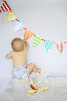 Cake Smash ideas : I like the pennants in the background and the plexi glass on the floor for the reflection.