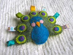 Felt Peacock Baby Rattle... Awww!! Someone have a baby girl already!!
