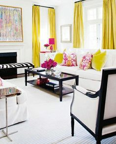 living room via kelley moore- Love the long yellow curtains with the yellow and the pop of pink (not sure if the hubby would go for pink)
