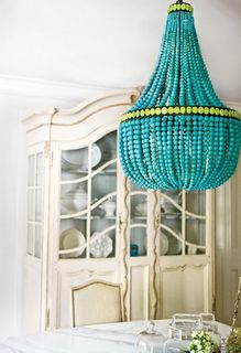 Crazy-cute blue & green beaded chandelier.  See this tutorial to make a similar one with dollar store items: http://dollarstorecrafts.com/2010/05/make-a-beaded-chandelier/  One change I would make would be to spray paint the metallic beads a glossy blue or white before putting the project together.