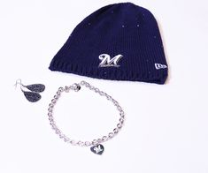 Get this look at the #Brewers Team Store:  Knit Hat- $35.00 Teardrop earrings- $60.00 Heart Charm Necklace- $40.00