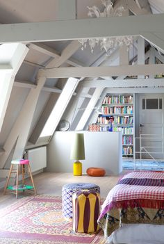 garage room redo. bright. white. pops of color. bookshelves. chandelier. rug. cheerful. awesome!