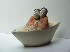orange - couple with boat -  figurative ceramic - Sjer Jacobs