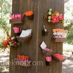 For a pretty twist on the typical candy bar, a florist made these wooden containers to hold all of the sweet treats at a wedding reception!