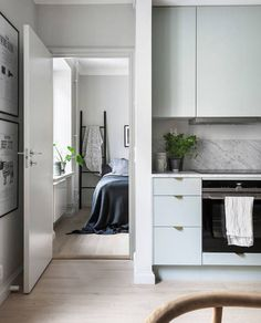 Mint green kitchen in a cozy living space - via Coco Lapine Design blog