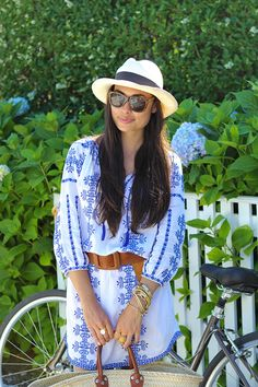 Turn your bathing suit cover up a dress by belting it and styling it with a beachy tote and a panama hat.