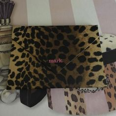 Avon Mark Pretty Wild Color Palette Gorgeous palette with very pretty leopard packaging. Used 2x during a vacation trip. Palette features 3 all over color & shimmer cream eyeshadows, 3 lip gloss and 1 all over color cream blush. Has a cute little mirror for on the go. Eye colors are Bronzed, Glammed, Smoked. Lipgloss colors are Lovie, Bitten, Tease. Blush color is Shimmered. Avon Mark Makeup Eyeshadow
