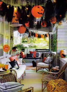 365 days of Halloween - Black tulle, paper lanterns from Oriental Trading, and lights / orange and black pillows - porch decor
