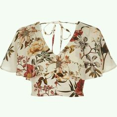 Crepe fabric Floral print Short cap sleeve Frill overlay Button placket Tie back detail Cropped length Loose fit V neck Our model wears a UK 8 and is Loose Crop Top, Loose Fit, Floral Crop Tops, Crop Shirt, Fashion Outfits, Womens Fashion, Pink Tops, Pretty Outfits, Crop Tops