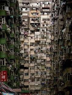Crowded Brown Apartment Building