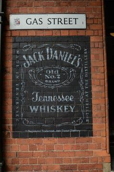 Image result for stencilling lettering on a faux brick wall